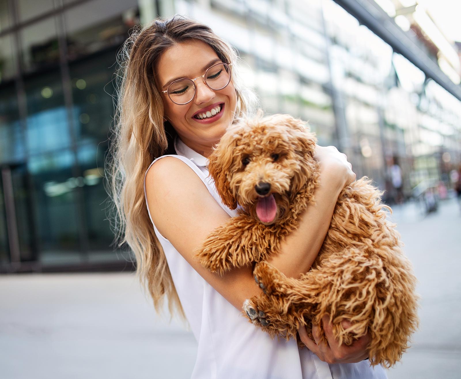 beauty-woman-with-her-dog-playing-outdoors-LN2XF4U.jpg
